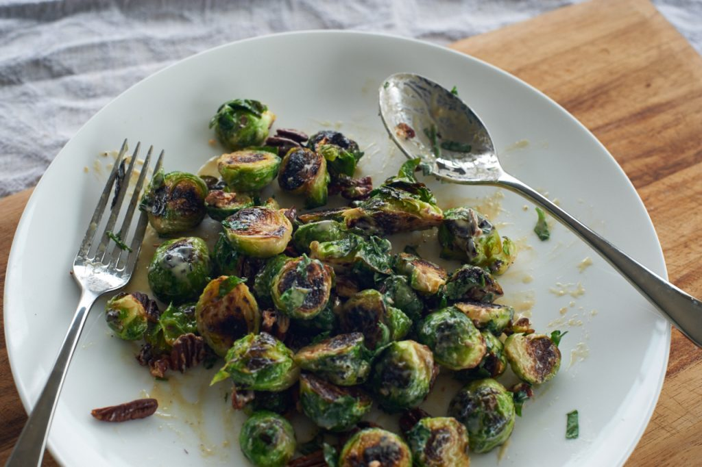 Fried sprouts with lemon tahini dressing